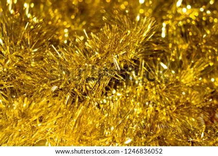 blur golden tinsel background. gold tinsel defocused background  #1246836052