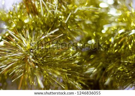 blur golden tinsel background. gold tinsel defocused background  #1246836055