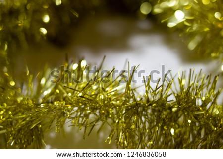 blur golden tinsel background. gold tinsel defocused background  #1246836058