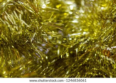 blur golden tinsel background. gold tinsel defocused background  #1246836061