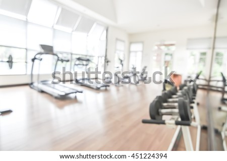 Blur gym background fitness center or health club with