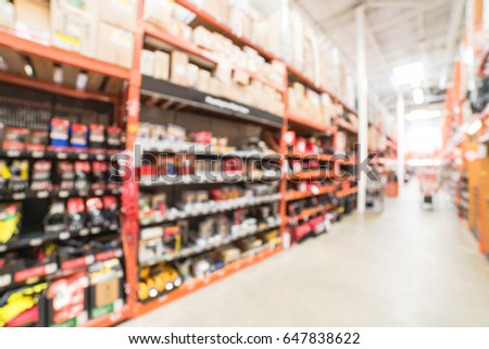 Blur hardware store in America. Defocused home improvement retailer, rack of drywall tools, join compound, rebar, deck boards, stair parts, wet/dry vacuums, tool boxes, child safety, building material