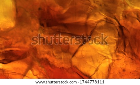 Blur Ice cube in whiskey texture background, macro close up of Ice cubes in glass of whiskey or another alcohol,Crystal design
