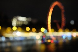 Blur image bokeh of London Eye, or the Millennium Wheel, is a cantilevered observation wheel on the South Bank of the River Thames in London, United Kingdom at night.