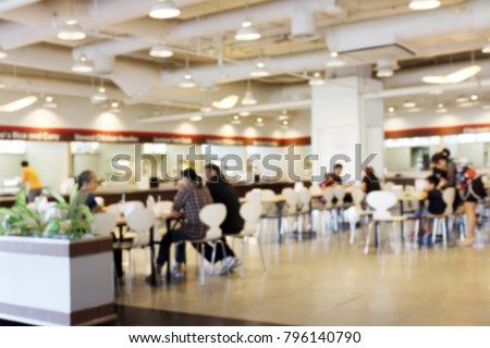 Blur image Canteen Dining Hall Room, A lot of people are eating food in University canteen blur background, Blurred background cafe or cafeteria