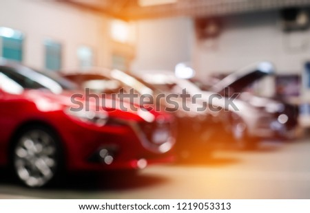 Blur image of car showroom background.