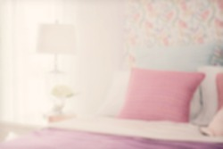 blur image of colorful bedding style with reading lamp