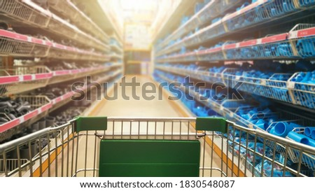 Blur image of consumer shopping in supermarkets plastic pvc and steel pipes and fittings in plumber store, for background. Сток-фото ©