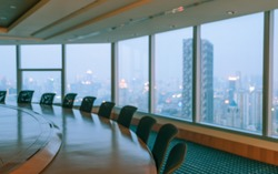 Blur image of empty boardroom with window cityscape background. Business concept