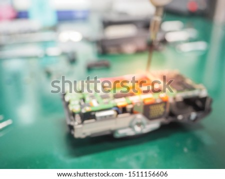 Blur image of Engineers repair circuit board with screwdriver, Abstract blurred of Repair of electronic devices, Repairing and service concept. #1511156606