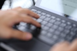 blur image of hand typing laptop keybord