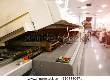 blur image of Machine SMT open cover Reflow oven for maintenance and cleaning at surface Mount Technology (SMT) for manufacturing of electronic equipment, blur background