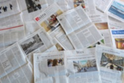Blur image of Newspaper with text and pictures