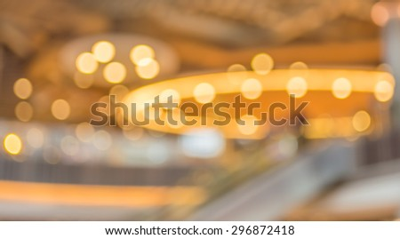 blur image of people in mall for background usage . #296872418