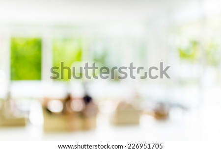 blur image of people sit in living room for background.