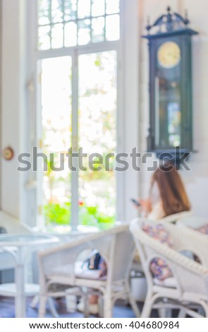 blur image of people sit in...