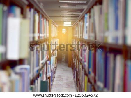 Blur image of picture library background and sun light.