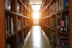 Blur image of picture library background. Library resources, including vast knowledge and sun light.