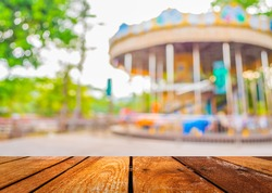 blur image of roundabout in theme park for background usage.
