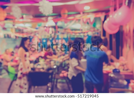 blur image of Tables and decoration prepared for birhtday party for background usage. (vintage tone)