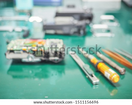 Blur image of workplace in laboratory with needed equipment and electronics device, Abstract blurred of Repair of electronic devices, Repairing and service concept. #1511156696
