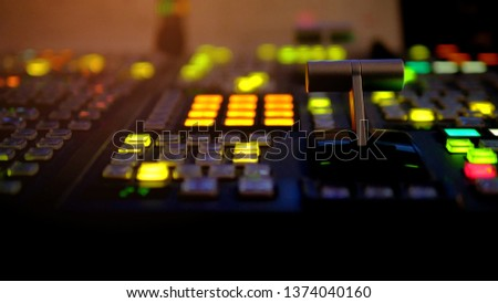 Blur image video switch of Television Broadcast, working with video and audio mixer, control broadcasts in recording studio. Broadcasting in the studio, professional mixing sender color buttons.
