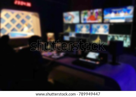 Blur image video switch of television broadcast, working with video and audio mixer, control broadcasts in recording studio. technology concept.