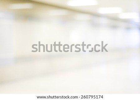 Blur inside office building with bokeh light background, business background