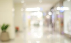 Blur light background at shop in mall for business background, blurry abstract bokeh at interior hallway