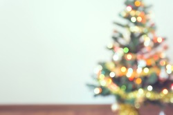 blur light celebration on christmas tree with white wall background