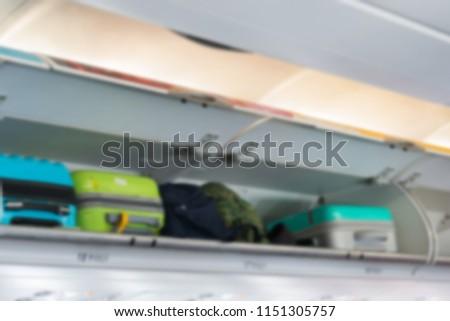 Blur luggage cabin on airplane #1151305757