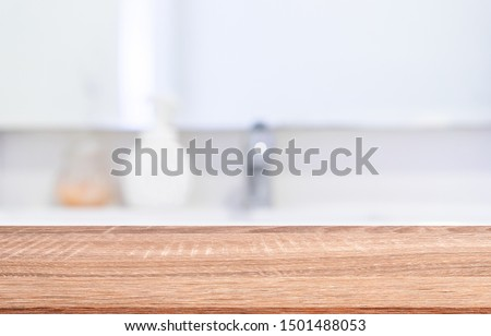 blur luxury modern bathroom background with modern brown wood tabletop for show,ads,design product on display concept