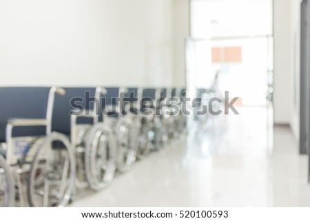 Blur medical abstract background hospital walk way corridor with patient\'s wheelchair for disabled person/ people: Blurry perspective view wheel chair seat row in clean clinical interior indoor space