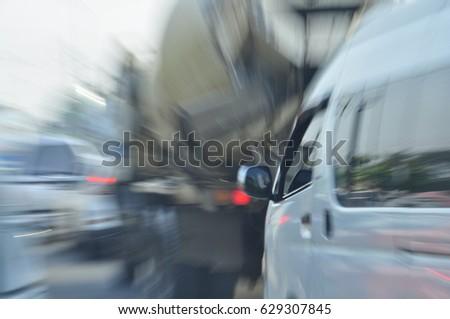 Blur motion near miss car crash.