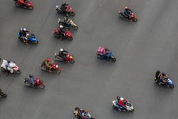 Blur motion people on motorcycles are moving on road, Aerial top view shot, selective focus at road.