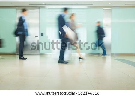 Blur Movement Business people walking in Rush Hour train station, London, UK