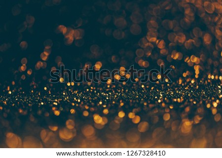 Blur neon gold and blue light circle background. Sparkling firework bokeh dots in vintage style. Luxury and classy new year and christmas celebration party textured dark backdrop. Blurry golden dust.
