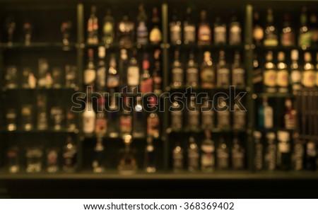 blur of bottles  counter bar ...