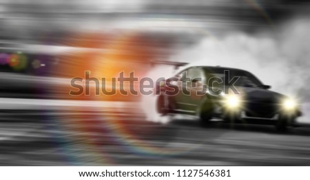 Blur of Car drifting, Sport car wheel drifting and smoking on blurred background.