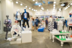 Blur of city shopping people crowd at marketplace shoe shop abstract background.