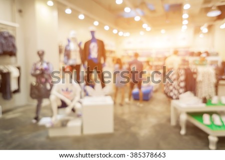 Blur of city shopping people crowd at marketplace shoe shop abstract background.vintage color