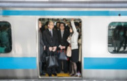Blur of crowd of people in the train in Japan in rush hour