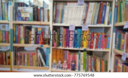 Blur of many children's books on small bookcases for kids learning and loving reading books in their own library. Kids's storybook for reading before bedtime story-time concept.