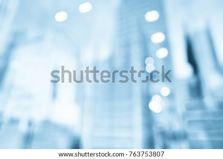 BLUR OF OFFICE BUILDINGS IN THE CITY FOR BUSINESS BACKGROUND #763753807