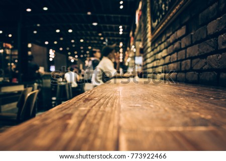 Blur of wood bar table in night cafe /selective focus images