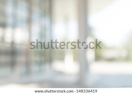 Blur office background building exterior view to lobby glass window wall with blurry light bokeh