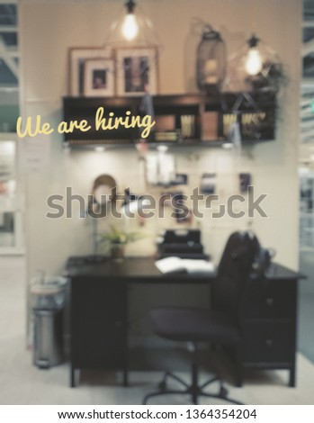 blur office background with 'we are hiring' text. job recruitment concept.