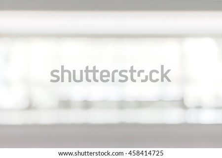 Blur office building corridor background interior view empty lobby hallway glass wall with blurry bright light bokeh #458414725