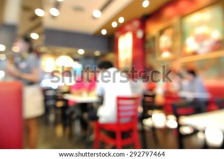 Blur or Defocus Background of People eating in Restaurant or Food Shop
