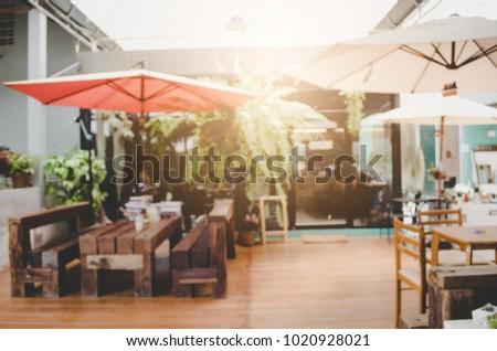 Blur or Defocus image of Coffee Shop or Cafeteria.Cafe interior out of focus - defocused background, vintage retro color #1020928021